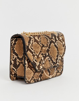 Asos Design DESIGN ring and ball cross body bag with chain strap in snake-Brown
