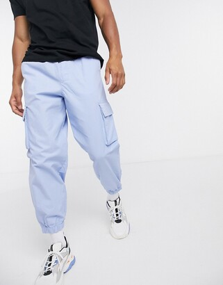 ASOS DESIGN oversized tapered cargo joggers in pastel blue