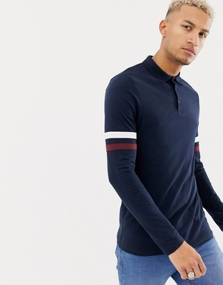 Asos Design DESIGN long sleeve polo shirt with contrast sleeve stripe in navy