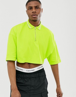 Asos Design DESIGN cropped oversized polo shirt with half sleeve and zip neck and tipping in neon green