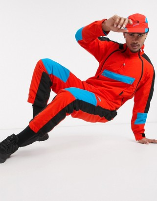 The North Face 92 Extreme wind suit in red