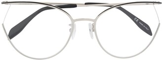 ALEXANDER MCQUEEN EYEWEAR AM0256O 002 SILVER SILVER TRANSPARENT Leather/Fur/Exotic Skins->Leather