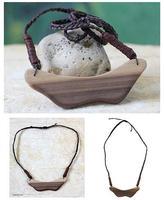 Handmade Wood Pendant Necklace, 'Brave Ashanti Queen'