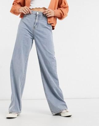 In The Style x Megan McKenna high waist wide leg jeans in blue