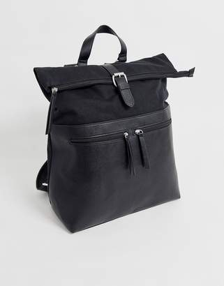 Asos Design DESIGN backpack in black with faux leather front double pockets