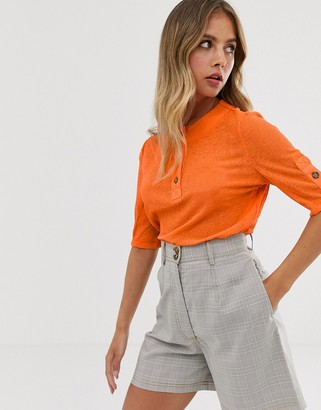 The East Order Sage button top-Orange
