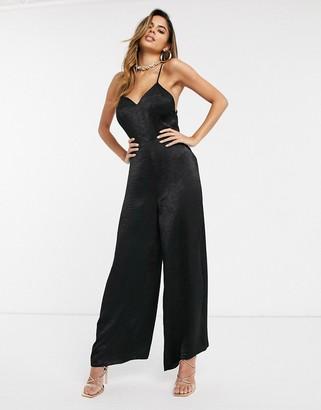 ASOS DESIGN cami strap satin jumpsuit with plunge front in black