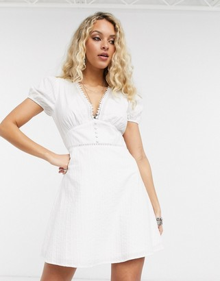 En Creme mini tea dress with ladder inserts and tie sleeves