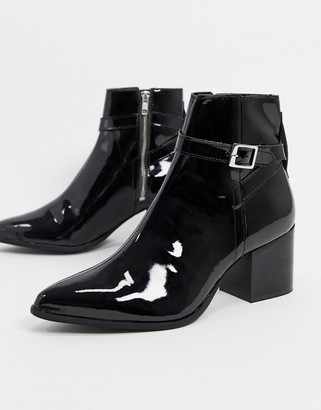 ASOS DESIGN heeled chelsea boots with pointed toe in black patent leather with strap detail