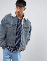 Asos Fully Borg Lined Oversized Denim Jacket In Blue Wash
