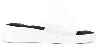 DKNY Mara embossed logo wedge slides