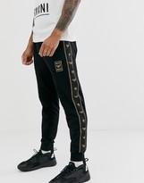 Emporio Armani gold logo taped sweatpants in black