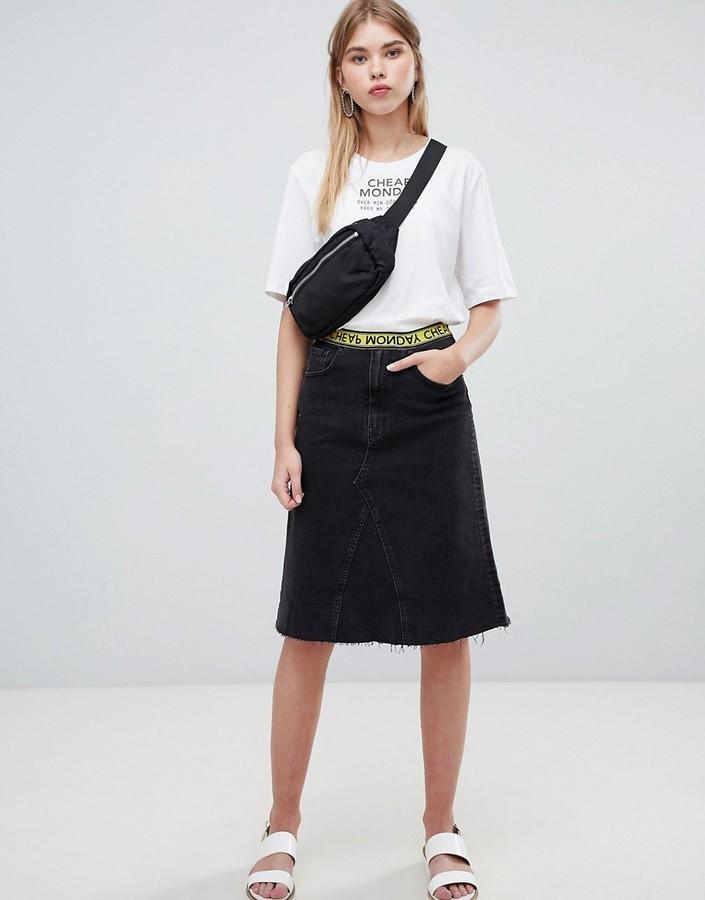 Cheap Monday organic mid length denim skirt with logo tape