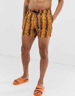 Asos Design DESIGN swim shorts in neon orange snake print short length