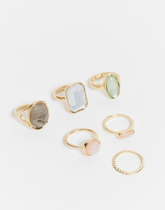 ASOS DESIGN pack of 6 rings with multi colored stones in gold tone