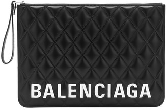 Balenciaga Logo quilted leather clutch