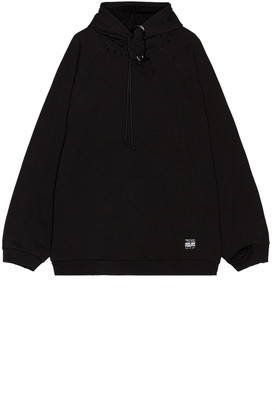 Raf Simons Destroyed Oversized Hoodie With Big Pin in Black | FWRD