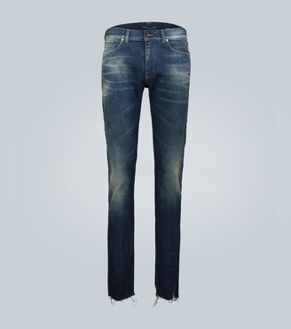 Saint Laurent Low-rise raw edge skinny jeans