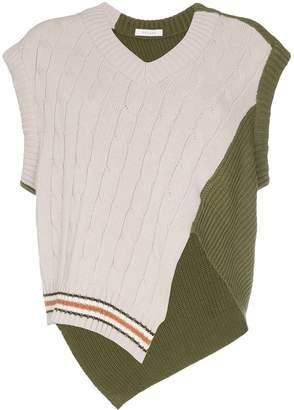 Delada asymmetric cable-knit jumper