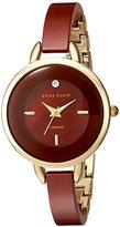 Anne Klein Women's AK/2132BYGB Diamond-Accented Gold-Tone and Burgundy Ceramic Bangle Watch