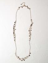 White Stuff Silk road mini disc necklace
