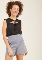 MCT1275 This black tank top is a true desk-to-dinner winner! A feminine look from our ModCloth namesake label, this crepey blouse boasts a tied high neckline, a peek-a-boo cutout, and petite ruffles trimming its edges. If you like detail, you'll love this ladylik