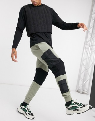 ASOS DESIGN skinny joggers with utility cargo colour blocking in khaki & black