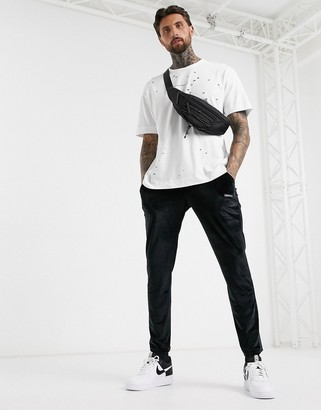 Good For Nothing oversized t-shirt in white with distressing and logo