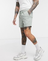 Asos Design DESIGN slim chino shorter shorts with elastic waist in washed green