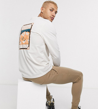 The North Face Faces long sleeve t-shirt in cream Exclusive at ASOS