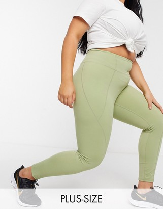 In The Style Plus x Courtney Black activewear panelled leggings in olive
