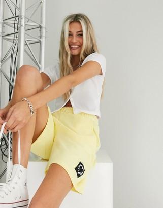 Bershka jersey jogger short in yellow