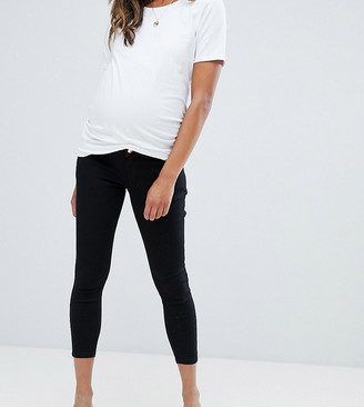 ASOS DESIGN Maternity Petite high rise ridley 'skinny' jeans in clean black with over the bump waistband