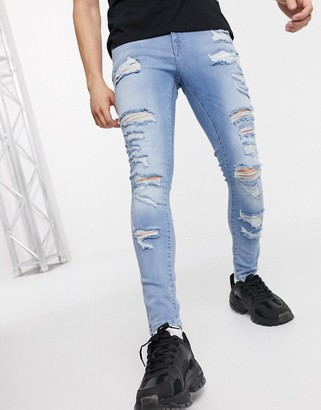 ASOS DESIGN spray on jeans with power stretch in light wash with heavy rips