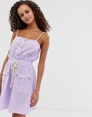 Asos Design DESIGN utility mini sundress with tie waist