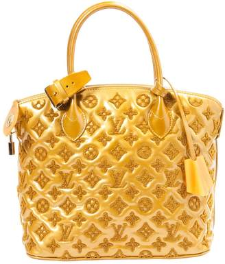 Louis Vuitton Gold Patent leather Handbag