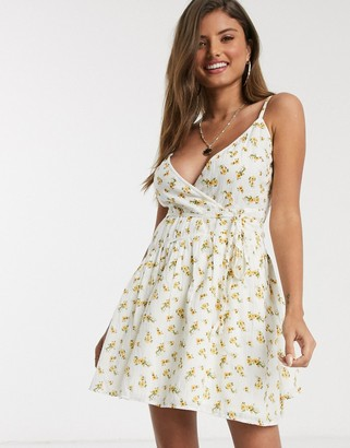 ASOS DESIGN tie wrap around crinkle mini sundress in floral print