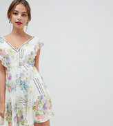 Asos DESIGN Petite ruffle sleeve mini dress in floral print with open back