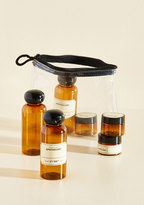 Kikkerland Set the Wheels in Potion Travel Bottle Set
