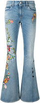 Gucci floral embroidered flares - women - Cotton - 26