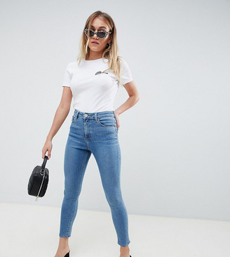 ASOS DESIGN Petite Ridley high waisted skinny jeans in pretty mid stonewash blue