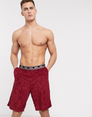 ASOS DESIGN lounge short in burgundy towelling and contrast branded waistband