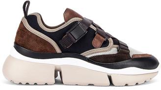 Chloé Sonnie Sneakers in Navy Ink   FWRD
