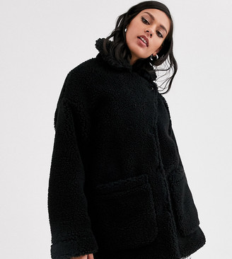 Monki longline teddy jacket with oversized pockets in black
