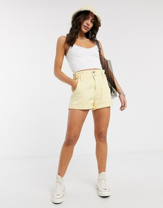 Bershka high rise elasticated waist shorts with roll hem in yellow