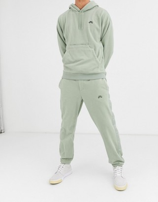 Nike SB fleece joggers with nomad side stripe and clip belt in khaki