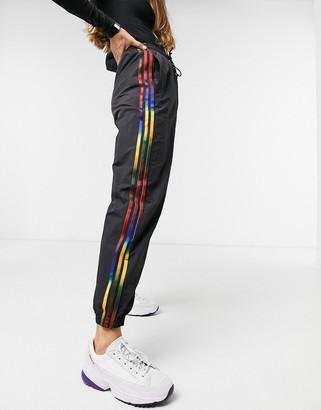adidas trefoil cuffed track pants in black