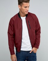 Asos Bomber Jacket With Zip Chest Pocket In Burgundy