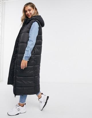 Monki Lizz recycled sleeveless long padded jacket in black