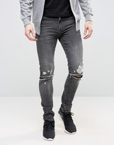 Asos Super Skinny Jeans With Knee Zip Rips In Washed Black
